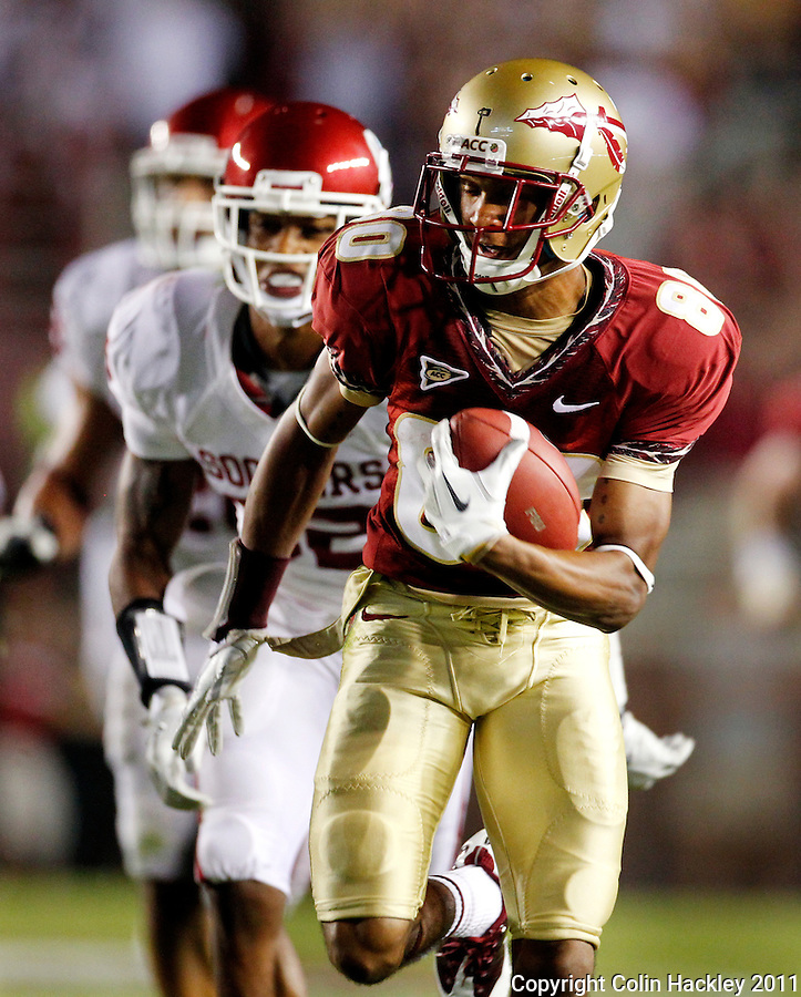 TALLAHASSEE, FL 9/17/11-FSU-OU091711 CH-Florida State's Rashad Greene heads for the endzone as Oklahoma's Jamell Fleming pursues during second half action Saturday at Doak Campbell Stadium in Tallahassee. The Seminoles lost to the Sooners 23-13..COLIN HACKLEY PHOTO