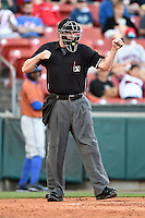 Umpire Chad Whitson makes a call during a game between the Durham Bulls and Buffalo Bisons on July 10, 2014 at Coca-Cola Field in Buffalo, New  York.  Durham defeated Buffalo 3-2.  (Mike Janes/Four Seam Images)