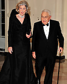 Former United States Secretary of State Henry A. Kissinger and his wife, Nancy, arrive for the State Dinner in honor of President Hu Jintao of China at the White House In Washington, D.C. on Wednesday, January 19, 2011. .Credit: Ron Sachs / CNP.(RESTRICTION: NO New York or New Jersey Newspapers or newspapers within a 75 mile radius of New York City)