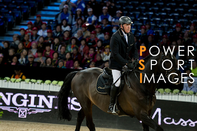 John Whitaker on Argento competes during competition Table A Against the Clock at the Longines Masters of Hong Kong on 19 February 2016 at the Asia World Expo in Hong Kong, China. Photo by Li Man Yuen / Power Sport Images