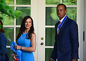 "Professional golfer Tiger Woods, right, and his girlfriend Erica Herman, on the colonnade after accepting the Presidential Medal of Freedom from United States President Donald J. Trump in the Rose Garden of the White House in Washington, DC on May 6, 2019.  The Presidential Medal of Freedom is an award bestowed by the President of the United States to recognize those people who have made ""an especially meritorious contribution to the security or national interests of the United States, world peace, cultural or other significant public or private endeavor.""<br /> Credit: Ron Sachs / CNP"