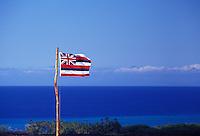 Hawaiian Flag flying over blue skies