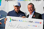 Paul Lawrie (SCO) receives the cheque from tournament host Miguel Angel Jimenez after winning at the end of the Final Day Sunday of the Open de Andalucia de Golf at Parador Golf Club Malaga 27th March 2011. (Photo Eoin Clarke/Golffile 2011)