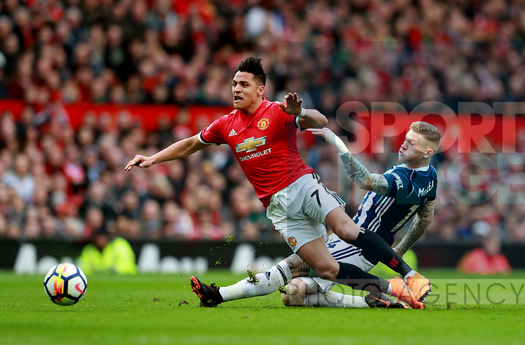 Alexis Sanchez of Manchester United tackled by James McClean of West Bromwich Albion during the premier league match at the Old Trafford Stadium, Manchester. Picture date 15th April 2018. Picture credit should read: Simon Bellis/Sportimage