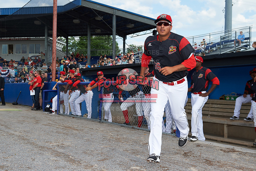 Batavia Muckdogs pitcher Javier Garcia (36) jogs to the field during introductions before a game against the Auburn Doubledays on June 19, 2017 at Dwyer Stadium in Batavia, New York.  Batavia defeated Auburn 8-2 in both teams opening game of the season.  (Mike Janes/Four Seam Images)