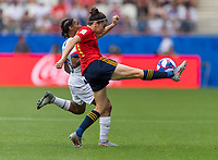REIMS,  - JUNE 24: Crystal Dunn #19 fights for the ball with Marta Corredera #7 during a game between NT v Spain and  at Stade Auguste Delaune on June 24, 2019 in Reims, France.