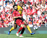 Liverpool's Mohamed Salah vies for possession with Wolverhampton Wanderers' Willy Boly<br /> <br /> Photographer Rich Linley/CameraSport<br /> <br /> The Premier League - Liverpool v Wolverhampton Wanderers - Sunday 12th May 2019 - Anfield - Liverpool<br /> <br /> World Copyright © 2019 CameraSport. All rights reserved. 43 Linden Ave. Countesthorpe. Leicester. England. LE8 5PG - Tel: +44 (0) 116 277 4147 - admin@camerasport.com - www.camerasport.com