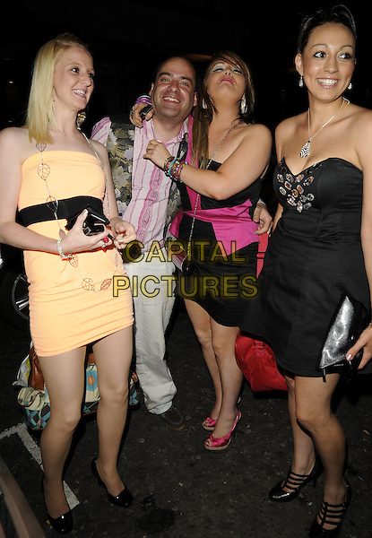 JONTY STERN & GUESTS .The Big Brother 10 launch party, Embassy nightclub, Old Burlington St., London, England..June 4th, 2009.BB10 full length black strapless dress pink one shoulder orange pink striped stripes floral print green waistcoat trousers arm over shoulder bag .CAP/CAN.©Can Nguyen/Capital Pictures.