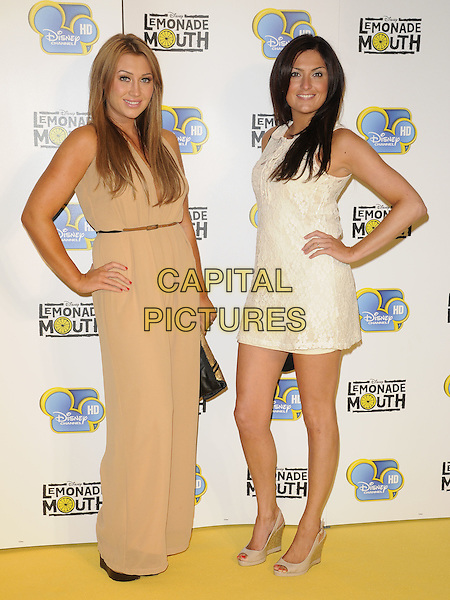 "LAUREN  GOODGER & guest.""Lemonade Mouth"" special TV screening, BAFTA, Piccadilly, London, England..August 25th, 2011.full length white cream beige dress hand on hip one shoulder.CAP/CAN.©Can Nguyen/Capital Pictures."