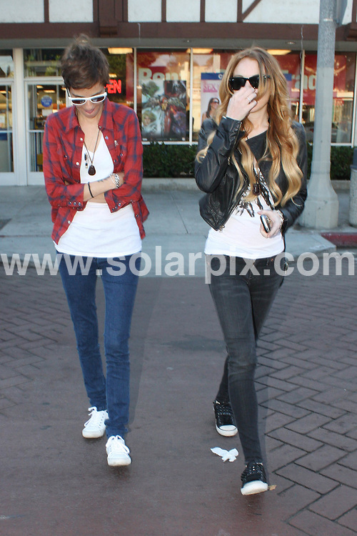 **ALL ROUND PICTURES FROM SOLARPIX.COM**.**WORLDWIDE SYNDICATION RIGHTS**.**NO PUBLICATION IN AUSTRALIA, NEW ZEALAND, DENMARK, GERMANY OR USA**.Lindsay Lohan and Samantha Ronson make a quick stop at Blockbuster Video to return recently rented movies. Hollywood, California, USA. 21st September 2008..JOB REF: 7425 LAP(HD)       DATE: 21_09_2008.**MUST CREDIT SOLARPIX.COM OR DOUBLE FEE WILL BE CHARGED* *UNDER NO CIRCUMSTANCES IS THIS IMAGE TO BE REPRODUCED FOR ANY ONLINE EDITION WITHOUT PRIOR PERMISSION*
