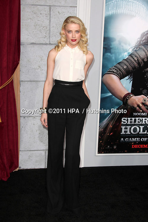 """LOS ANGELES - DEC 6:  Amber Heard arrives at the """"Sherlock Holmes: A Game of Shadows"""" Los Angeles Premiere at Regency Village Theatre on December 6, 2011 in Westwood, CA"""