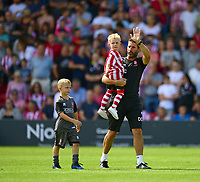 Lincoln City manager Danny Cowley with one of the young mascots before kick off<br /> <br /> Photographer Chris Vaughan/CameraSport<br /> <br /> The EFL Sky Bet League Two - Lincoln City v Swindon Town - Saturday 11th August 2018 - Sincil Bank - Lincoln<br /> <br /> World Copyright &copy; 2018 CameraSport. All rights reserved. 43 Linden Ave. Countesthorpe. Leicester. England. LE8 5PG - Tel: +44 (0) 116 277 4147 - admin@camerasport.com - www.camerasport.com
