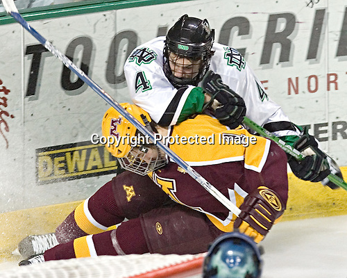 Taylor Chorney, Justin Bostrom - The University of Minnesota Golden Gophers defeated the University of North Dakota Fighting Sioux 4-3 on Friday, December 9, 2005, at Ralph Engelstad Arena in Grand Forks, North Dakota.