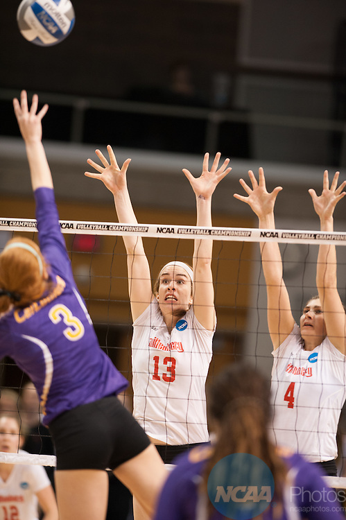 21 NOV 2015: Wittenberg's Emily Kahlig, middle, and Melissa Emming attempt to block the spike of Cal Lutheran's Sarah Pappas during the Division III Women's Volleyball Championship held at Van Noord Arena on the Calvin University campus in Grand Rapids, MI. Cal Lutheran defeated Wittenberg 3-0 for the national title. Erik Holladay/NCAA Photos