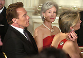 California Gov. Arnold Schwarzenegger (L) and Kansas Gov. Kathleen Sebelius listen as U.S. President George W. Bush makes remarks at a State Dinner in honor of the nation's governors, February 25, 2007 at the White House in Washington. The National Governor's Association is holding it's annual Winter meetings in Washington.   POOL PHOTO by Mike Theiler/EPA