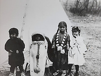 Children of Ute hunters, who guided and fed Spanish explorers who first arrived in the mid-1700s, photograph, from the Anasazi Heritage Center, an archaeological museum of Native American pueblo and hunter-gatherer cultures, Dolores, Colorado, USA. Picture by Manuel Cohen