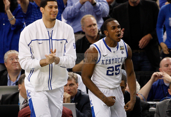 Kentucky Wildcats guard Marquis Teague and Eloy Vargas celebrate a good run during the second half of the UK vs. Louisville National Semi-finals at the Super Dome in New Orleans, Louisiana  March 31, 2012.. Photo by Brandon Goodwin | Staff