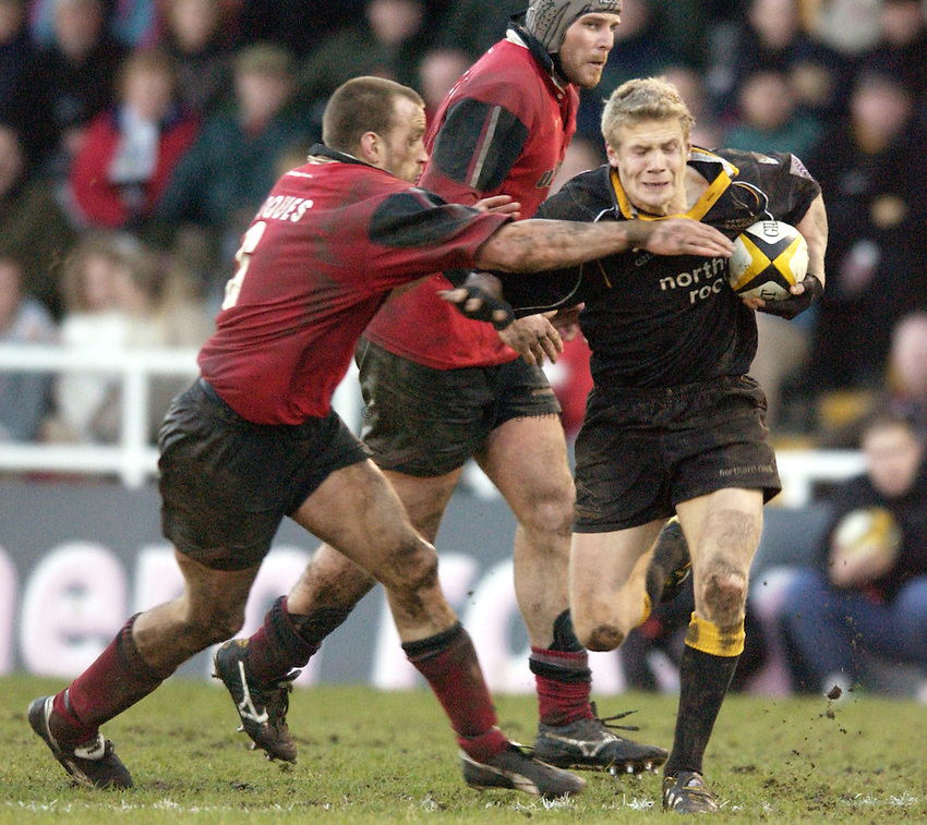 Photo. Jed Wee.Newcastle Falcons v Saracens, Parker Pen Challenge Cup, Kingston Park, Newcastle. 19/01/2003..Newcastle's Michael Stephenson (R) with Saracens' Tony Roques.