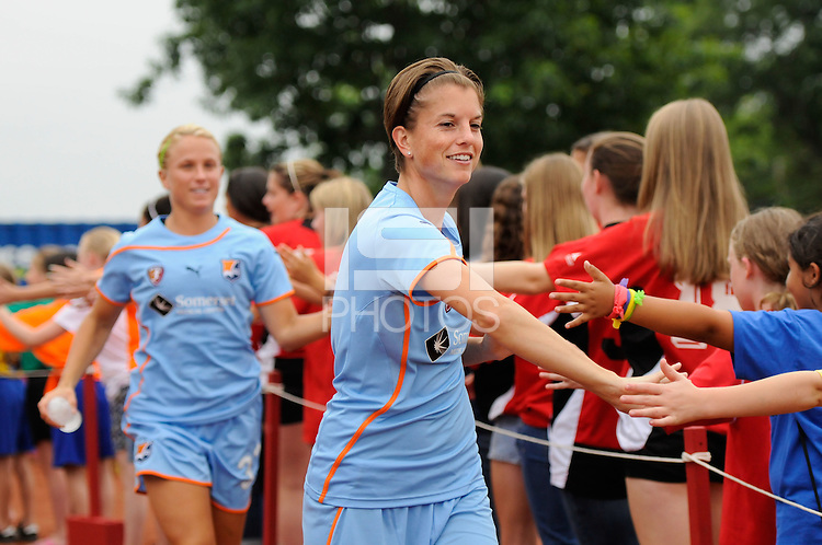 Angie Kerr (6) of Sky Blue FC greets fans before the match. Sky Blue FC and the Boston Breakers played to a 0-0 tie during a Women's Professional Soccer (WPS) match at Yurcak Field in Piscataway, NJ, on June 12, 2011.