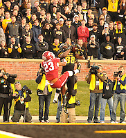 NWA Media/Michael Woods --11/28/2014-- w @NWAMICHAELW...University of Arkansas defender Tevin Mitchel tries to defend the pass to Missouri receiver Jimmie Hunt as he pulls in a touchdown catch in the 4th quarter of Friday afternoons game at Faurot Field in Columbia Missouri.