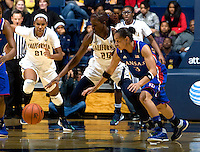 Gennifer Brandon of California tries to control the ball away from Angel Goodrich of Kansas during the game at Haas Pavilion in Berkeley, California on December 21st, 2012.  California defeated Kansas, 88-79.