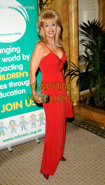 SALLY FARMILOE.The Ndoro Children's Charities fundraising gala at The Dorchester Hotel, London, England. .September 17th, 2009 .full length red long maxi dress silver clutch bag.CAP/CAN.©Can Nguyen/Capital Pictures.