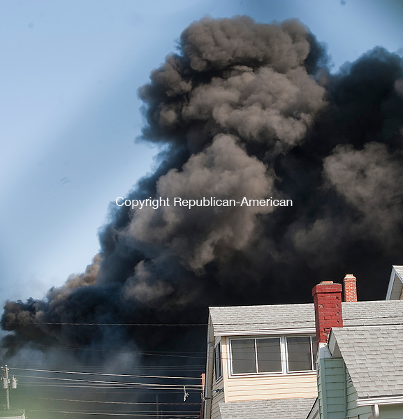 TORRINGTON, CT-040314JS04-Smoke from tires in a warehouse filled the skies inTorrington on Thursday morning. <br /> Jim Shannon Republican-American