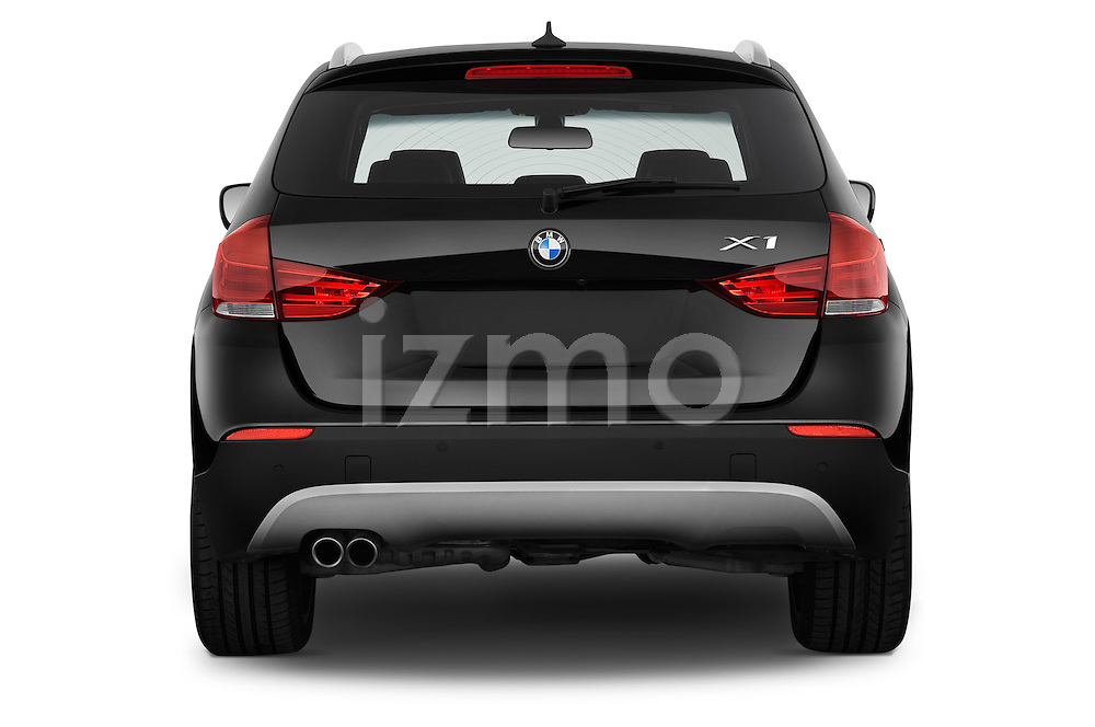 Straight rear view of a 2012 Bmw X1 xDrive20d 5 Door Suv 2WD Stock Photo
