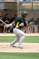 Aaron Shipman #14 of the Oakland Athletics plays in an extended spring training game against the Chicago Cubs at the Athletics minor league complex on May 18, 2011  in Phoenix, Arizona. .Photo by:  Bill Mitchell/Four Seam Images.