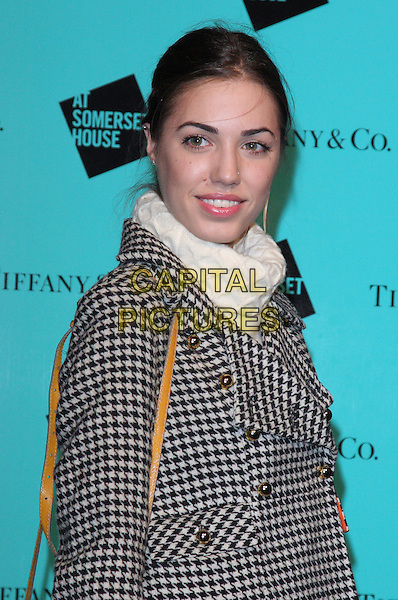 AMBER LE BON .at Somerset House Ice Rink - VIP Launch Party, London, England, UK, .November 16th 2009.lebon half length black cream white polo neck  black and checked coat gingham check hair up houndstooth gold brass buttons .CAP/ROS.©Steve Ross/Capital Pictures