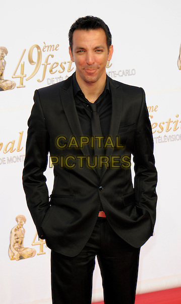 DOUDI.Opening night of the 49th Monte Carlo Television Festival at the Grimaldi Forum, Monte Carlo, Monaco..June 7th, 2009.half length hand sin pockets black suit jacket .CAP/RD.©Richard Dean/Capital Pictures.