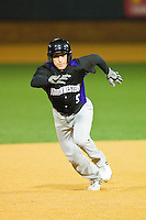 Kyle Ruchim #9 of the Northwestern Wildcats takes off for third base against the Wake Forest Demon Deacons at Gene Hooks Field on February 26, 2011 in Winston-Salem, North Carolina.  Photo by Brian Westerholt / Four Seam Images