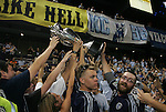 08 August 2012: KC fans in the Members Stand pass the championship trophy around. Sporting Kansas City won the championship over Seattle Sounders FC 3-2 on penalties after the game ended in a 1-1 tie at Livestrong Sporting Park in Kansas City, Kansas in the 2012 Lamar Hunt U.S. Open Cup Final.