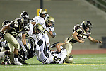 Torrance, CA 11/05/10 - Joey Augello (Peninsula #58), Josh Girardini (West # 82), Ricky Sato (West # 25) and Logan Okuda (Peninsula #25) in action during the Peninsula vs West varsity football game played at West Torrance high school.