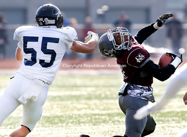 Naugatuck, CT- 26 November 2015-112615CM08-  Ansonia's Keith Zdep (55) tries to bring down Naugatuck's Antoine Sistrunk during their Thanksgiving matchup in Naugatuck on Thursday.  The Chargers would rout the Greyhounds,  41-8.   Christopher Massa Republican-American