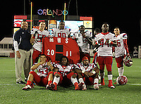 Manatee Hurricanes players including Blake Keller #55, DeMarcus Christmas #90, Marquis Dawsey #43, John McElfresh #53, Jorelle Simmons #58, Tyler Bradford #56, Deandre Sanders #64, and Kelvin Carter #44 pose for photos after the Florida High School Athletic Association 7A Championship Game at Florida's Citrus Bowl on December 16, 2011 in Orlando, Florida.  Manatee defeated First Coast 40-0.  (Mike Janes/Four Seam Images)