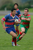 P. Baird chases V. Fatu as he makes a strong run upfield. Counties Manukau Premier Club Rugby, Ardmore Marist vs Waiuku played at Bruce Pulman Park, Papakura on the 29th of April 2006. Ardmore Marist won 10 - 9.