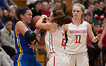 WINSTED,  CT-021919JS08-  Gilbert's Angie Delacruz (11) and Northwestern's Francesca DeSanti (2) battle for the ball while Skylar Dimartino (11) look on during their Berkshire League semi-final game Tuesday at Northwestern Regional High School in Winsted. <br /> Jim Shannon Republican American