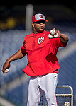 28 April 2017: Washington Nationals Bullpen Catcher Nilson Robledo tosses batting practice prior to a game against the New York Mets at Nationals Park in Washington, DC. The Mets defeated the Nationals 7-5 to take the first game of their 3-game weekend series. Mandatory Credit: Ed Wolfstein Photo *** RAW (NEF) Image File Available ***