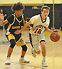Ryan Prendergast #12 of South Side, right, gets pressured by Ty-Shon Pannell #3 of Central Islip during a non-league game Islip in the Richard Brown Nassau-Suffolk Challenge at Uniondale High School on Saturday, Jan. 14, 2017. South Side won by a score of 67-61.