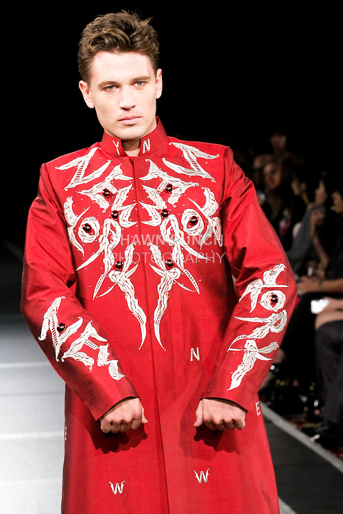 Model walks the runway in a Siraj Sanad outfit for the Siraj Sanad Spring 2011 runway show, during Couture Fashion Week, September 12, 2010.