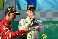 March 26, 2017: Valtteri Bottas (FIN) #77 from the Mercedes AMG Petronas team drinks from the champagne bottle on the podium at the 2017 Australian Formula One Grand Prix at Albert Park, Melbourne, Australia. Photo Sydney Low