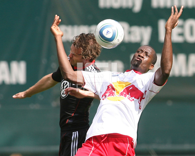 Carey Talley #8 of D.C. United goes for a header with Ibrahim Salou #29 of the New York Red Bulls during an MLS match on May 1 2010, at RFK Stadium in Washington D.C.