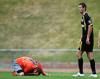 Waikato's Daniel Peat clutches his face as Trent Watson (right) protests..NZFC soccer  - Team Wellington v Waikato FC at Newtown Park, Wellington. Sunday, 20 December 2009. Photo: Dave Lintott/lintottphoto.co.nz