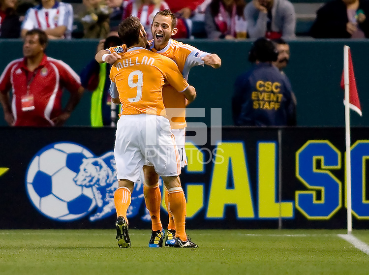 Houston Dynamo midfielder Brad Davis (11) begins to celebrate after scoring a goal with teammate Brian Mullan (9). The Houston Dynamo defeated CD Chivas USA 2-0 at Home Depot Center stadium in Carson, California on Saturday May 8, 2010.  .