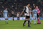 Mario Hermoso of Atletico Madrid is booked by referee Anthony Taylor for a foul on Paulo Dybala of Juventus during the UEFA Champions League match at Juventus Stadium, Turin. Picture date: 26th November 2019. Picture credit should read: Jonathan Moscrop/Sportimage