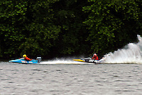Frame 2: Marissa Affholder(151-M) races into turn 2 chasing 17-M and flips over. (stock outboard runabout)