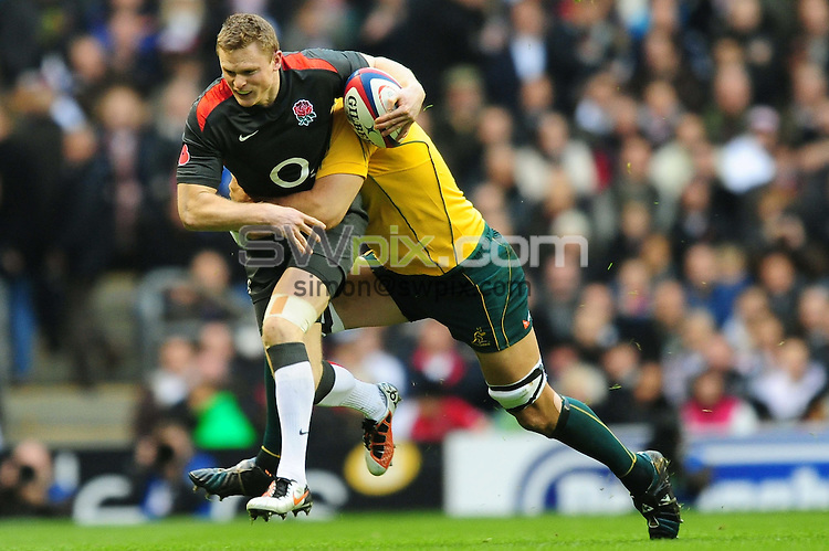 PICTURE BY ALEX BROADWAY/SWPIX.COM - Rugby Union - England v Australia - Investec Internationals, Twickenham, England - 13/11/10...Copyright - Simon Wilkinson - 07811267706...Chris Ashton of England is tackled by Nathan Sharpe of Australia.....