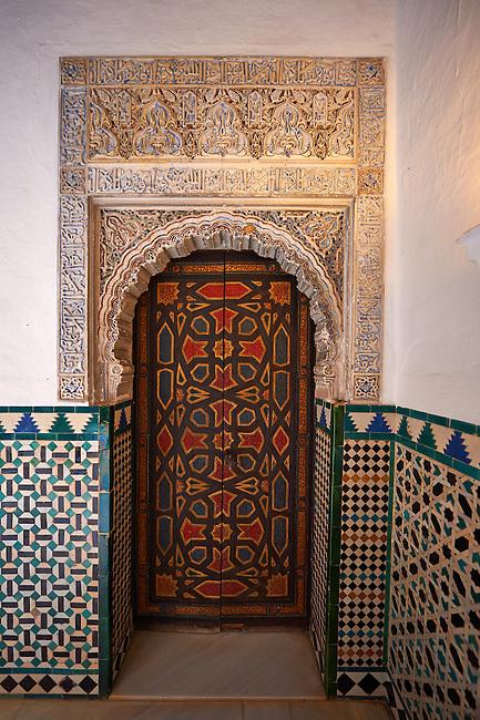 Arabesque Mudjar plasterwork and Zillige tiles of of the 12th century ) Alcazar of Seville, Seville, Spain