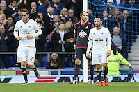 Lukasz Fabianski shouts out in frustration Gylfi Sigurdsson and Leon Britton look dejected after Everton equalise during the Barclays Premier League match between Everton and Swansea City played at Goodison Park, Liverpool